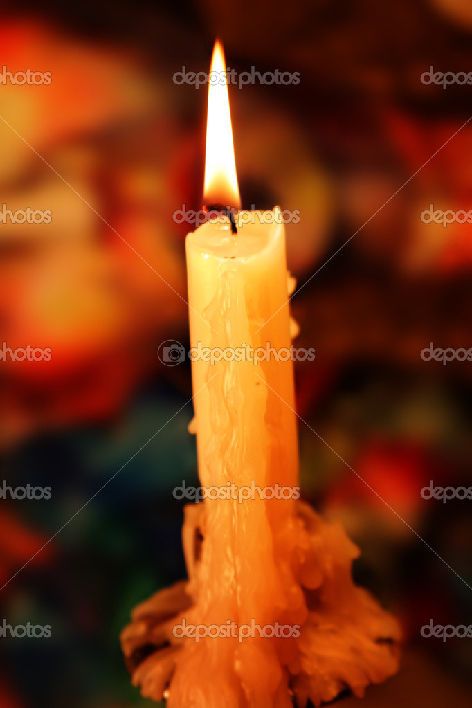 Candle lit with flame and golden light — Stock fotografie #8449796