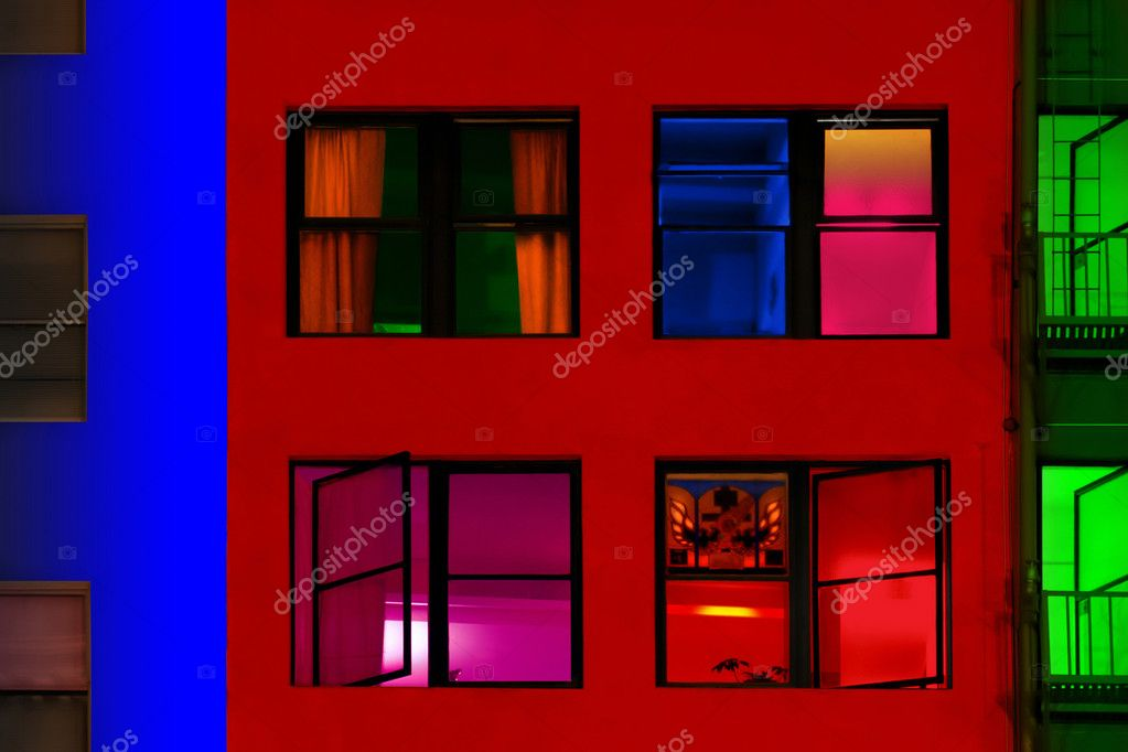 Colorful buildings attached to each other in a row photographed at night  Stock Photo #8449971