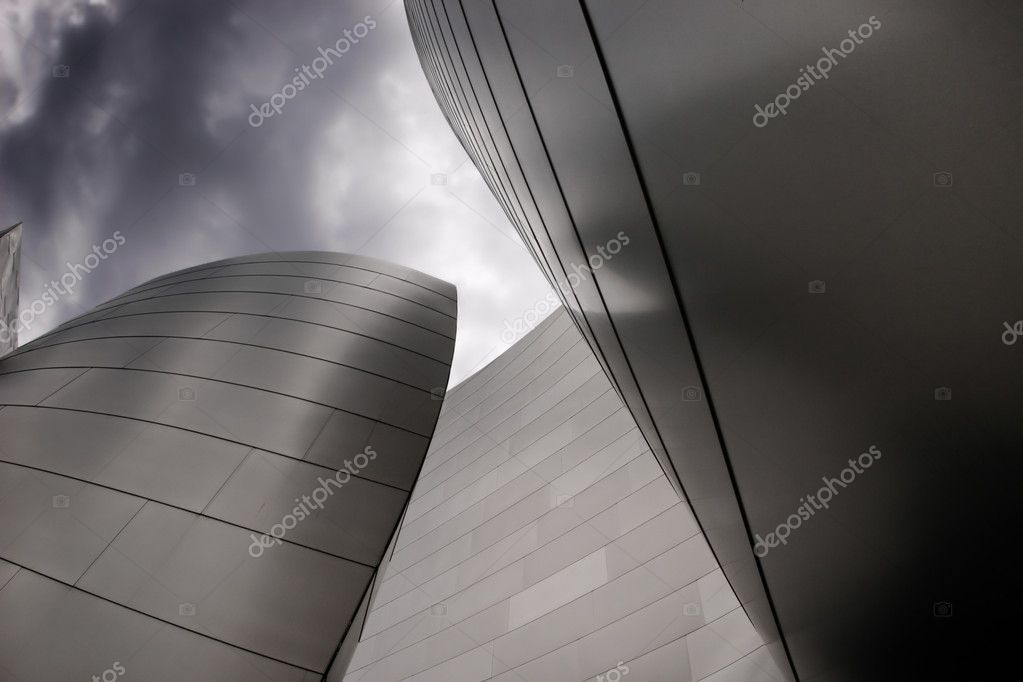 Modern curvet building with metal on a dark cloudy sky  Stock Photo #8449981