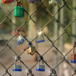 Colorful locks on fence — Stock Photo