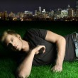 Young man laying on grass - Photo