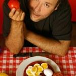 Man with tomato — Stock Photo