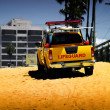 Lifeguard truck on beach — Stock Photo