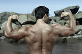 Body builder by the rocks — Stock Photo