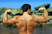 Body builder flexing his back — Stock Photo