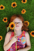 Little girl with bee on nose — Stock Photo