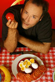 Man with tomato — Stock Photo