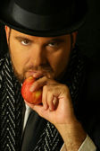 Sinister man with apple — Stock Photo