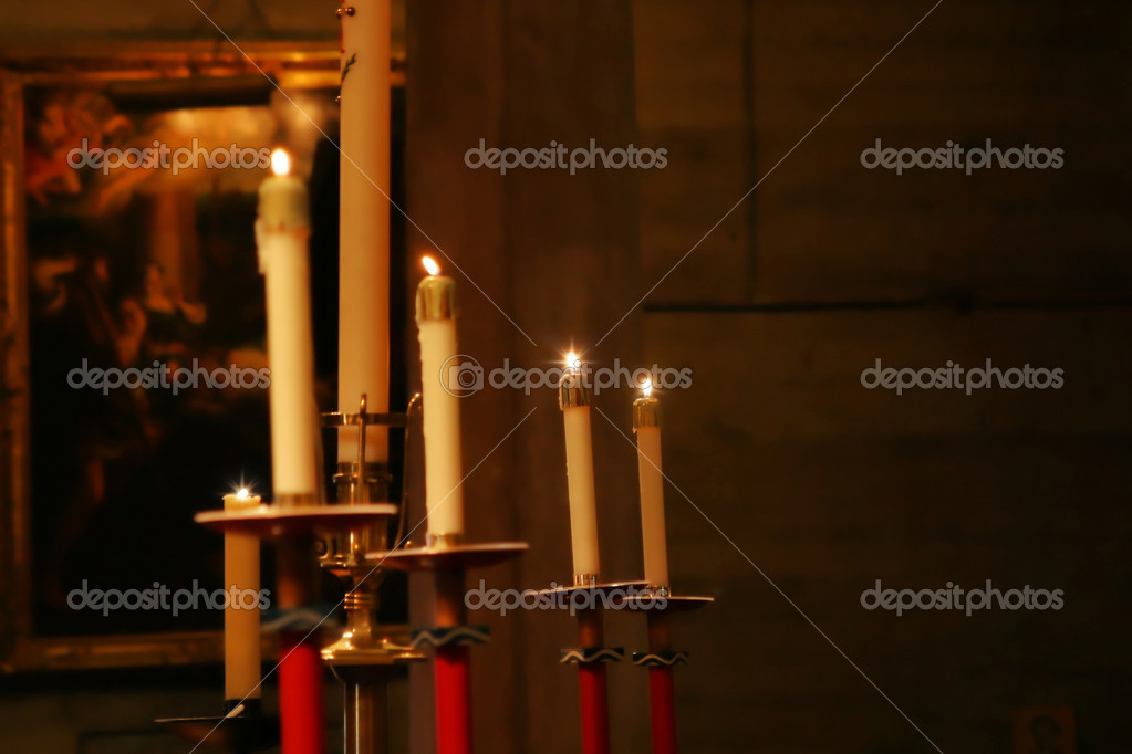 Lit candles displayed in church — Stock Photo #8451879