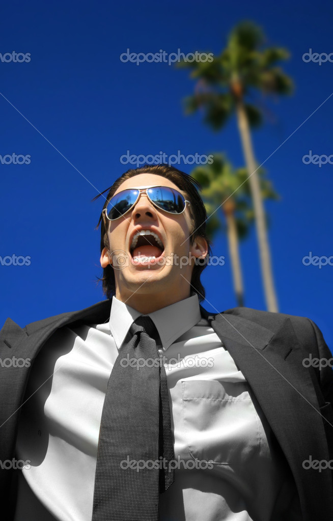 Young business man yelling against a blue sky — Stock Photo #8451919