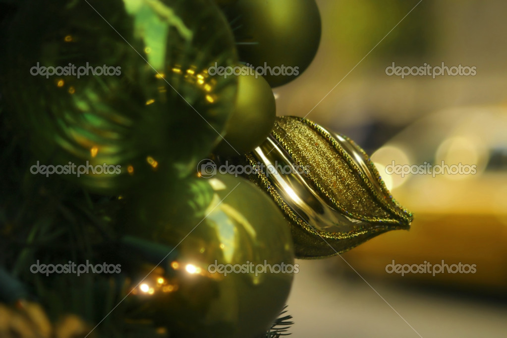 Close up of green Christmas ornament with blurred taxi in background — Stock Photo #8453134