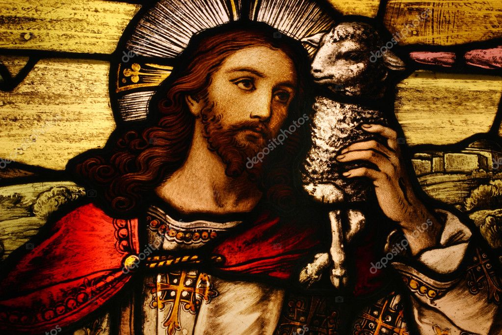 Stained glass depicting Jesus holding a lamb — Stock Photo #8453306