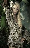Female model in tropical setting — Stock Photo