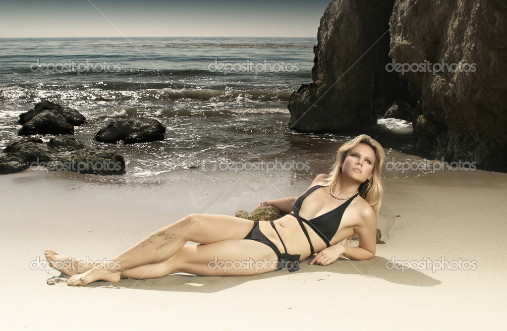 Horizontal full body portrait of beautiful blond model in bikini on beach  Stock Photo #8469330