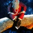 Santa and Snow at night - Stock Photo