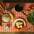 Table set with food and checkered cloth - Stock Photo