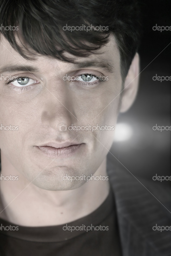 Close-up portrait of a serious young male model — Stock Photo #8470716