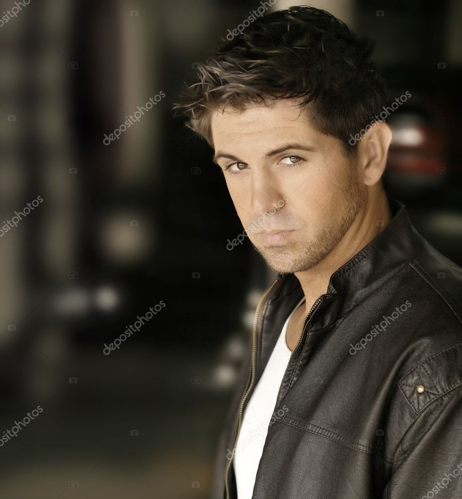 Portrait of good looking young male model in leather jacket — Stock Photo #8471084