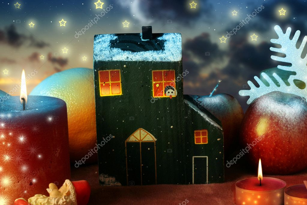 Little house with candles and stars in a christmas scenery — Stock Photo #8471286
