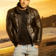 Man in golden light wearing a leather jacket — Stock Photo
