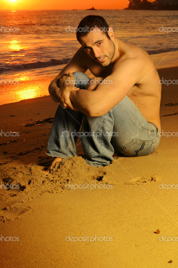 Casual shirtless good looking man on the beach at sunset in golden light  — Stock Photo #8485915