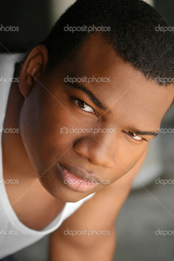 Close-up portrait of young good looking African American man — Stock Photo #8488102