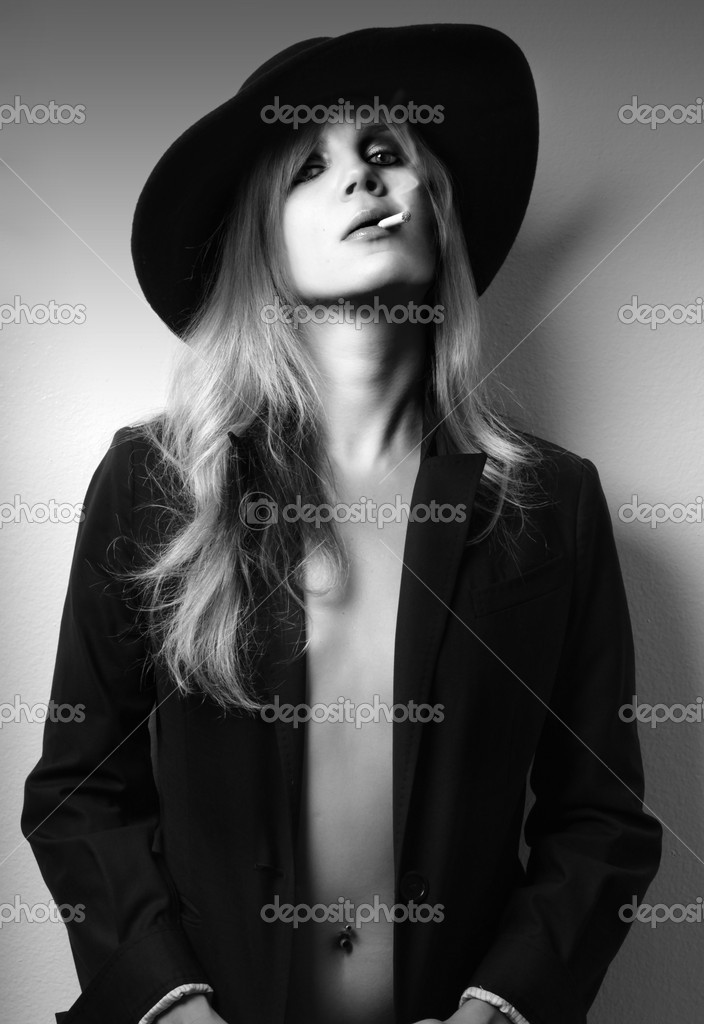 Glamor fashion shot of sexy female model in black and white smoking  — Stock Photo #8489940