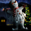 Fun snowman at night — Stockfoto