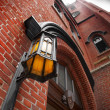 Royalty-Free Stock Photo: Lamp on Brick