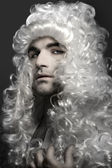 Young man in wig — Stock Photo