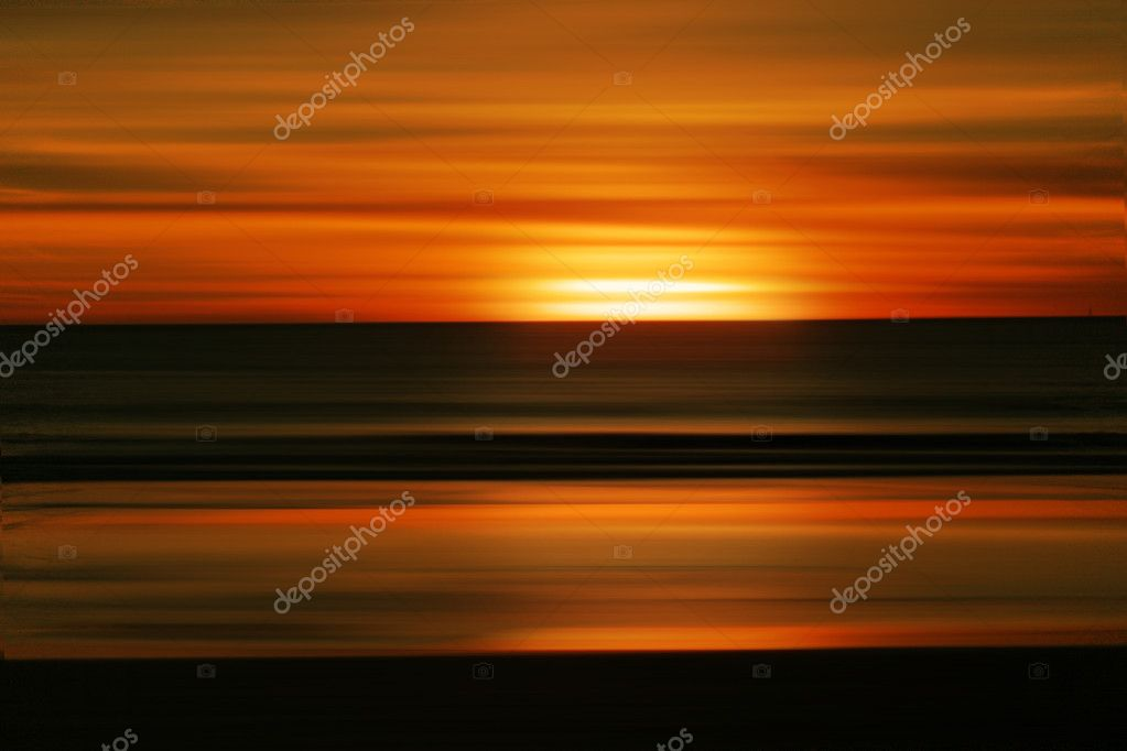 Abstract sunrise or sunset background against blurred ocean — Stock Photo #8500158