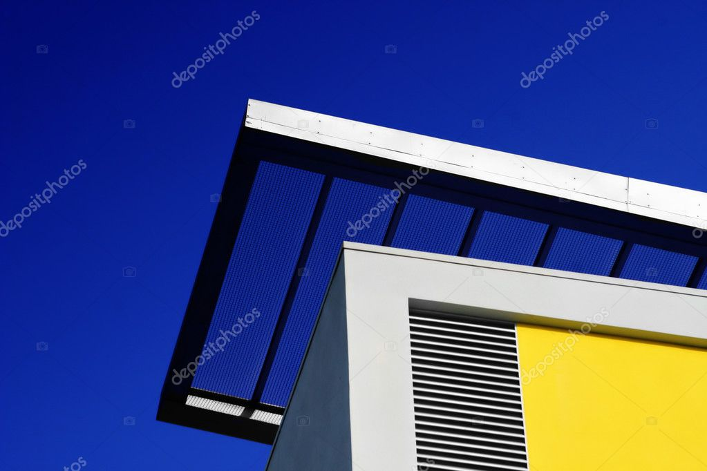 Detail of a modern building in metal with bright blue sky  Stock Photo #8500454