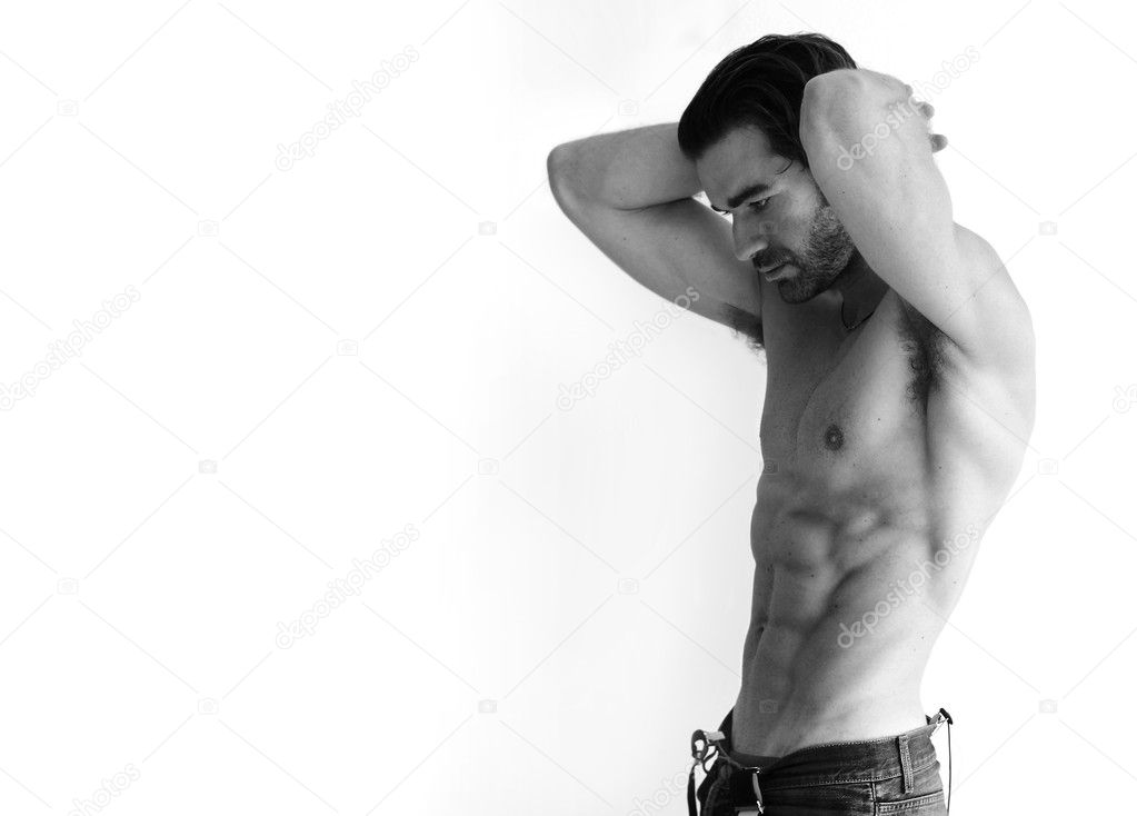 Black and white portrait of a sexy young shirtless man against white background with lots of copy space  Stock Photo #8501245