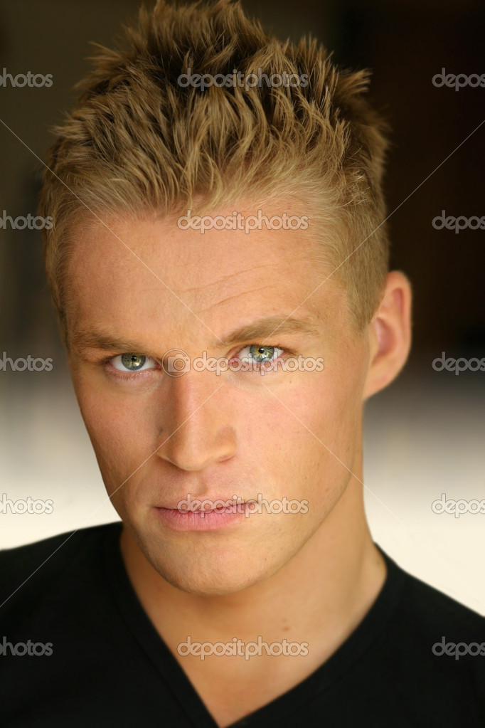 Portrait of a young good looking blond male model — Stock Photo #8501655
