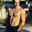 Male fitness model outdoors — Stock Photo #8511009