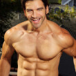 Happy shirtless muscular man — Stockfoto