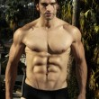 Sexy male fitness model outdoors - Stock Photo