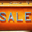 Sale sign on a vintage suitcase — Stock Photo
