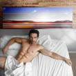 Cool guy in bed — Stock Photo