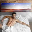 Cool guy in bed — Stock Photo #8512884