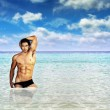Sexy man in ocean - Stock Photo