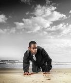 Fashion male model on beach — Stock Photo