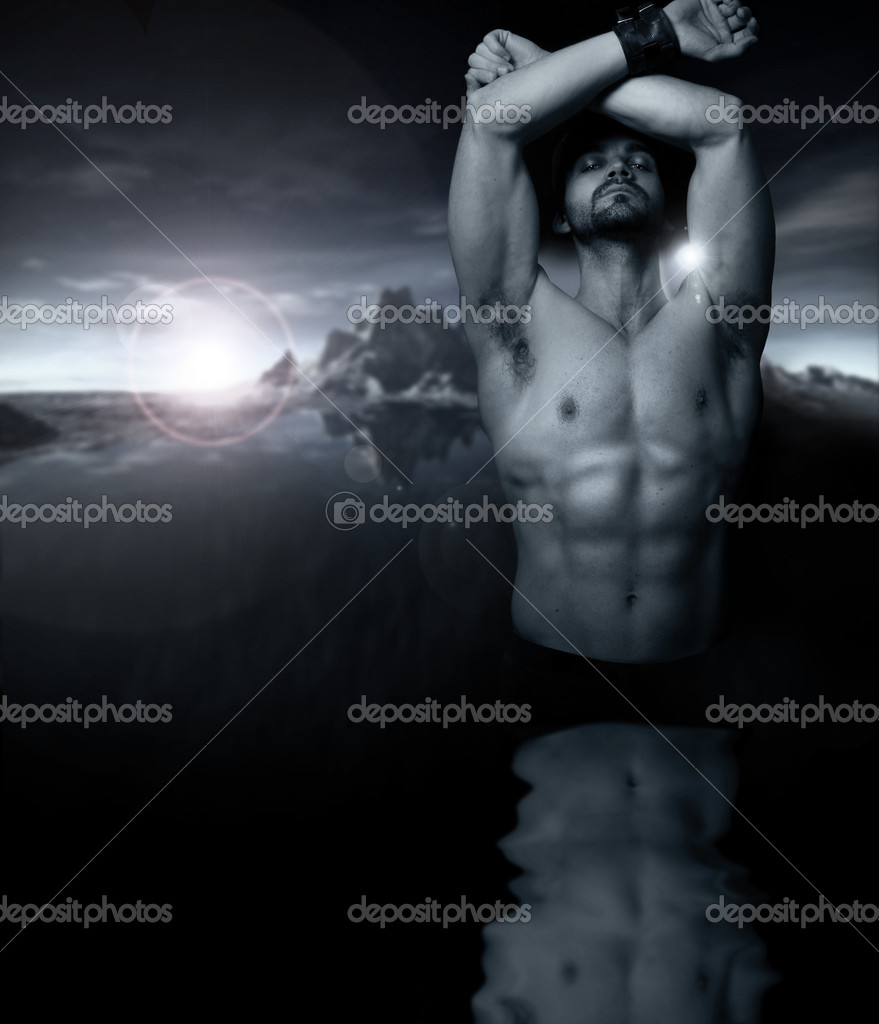 Fantastical stylized fine art portrait of a shirtless man emerging from reflective water with setting sun and mountains in background — Stock Photo #8510935