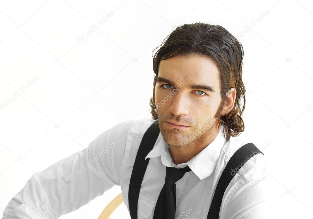 Portrait of a stylish young businessman in white shirt, black tie and suspenders against white background — Stock Photo #8511830