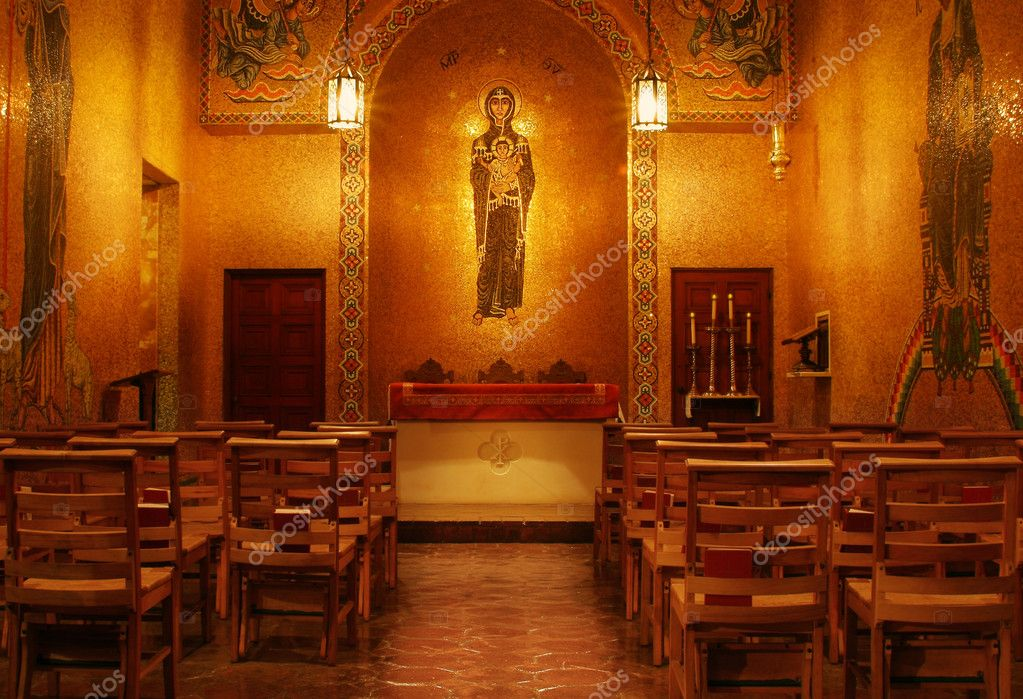 Beautiful church interior encased in gold tile with simple wooden chairs — Stock Photo #8512222