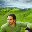 Portrait of a relaxed good-lookiing young man in natural setting — Stock Photo #8521523