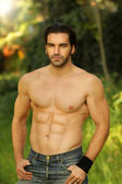 Outdoor portrait of a shirtless good looking fit male model — Stock Photo