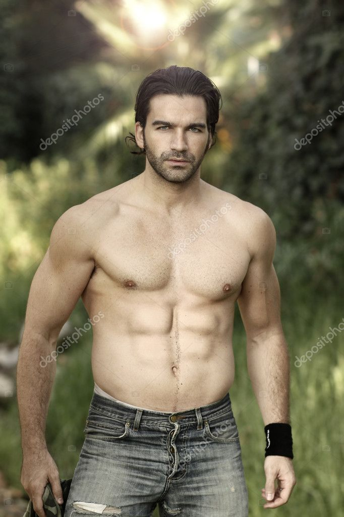Portrait of a hunky male fitness model shirtless in beautiful outdoor natural setting — Stock Photo #8520881