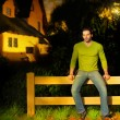 Man on fence — Stockfoto