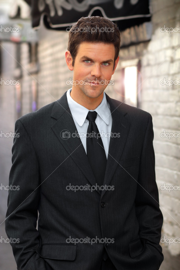Happy confident young businessman male model in suit and tie — Stock Photo #8761805